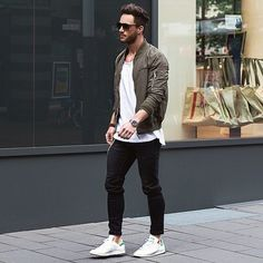 Consider teaming an olive bomber jacket with black jeans for an easy to wear, everyday look. A pair of white low top sneakers will seamlessly integrate within a variety of outfits.   Shop this look on Lookastic: https://lookastic.com/men/looks/olive-bomber-jacket-white-crew-neck-t-shirt-black-jeans/18233   — Olive Bomber Jacket  — White Crew-neck T-shirt  — Black Jeans  — White Low Top Sneakers