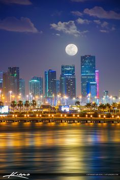 Beautiful moon setting behind the Miami Skyline buildings in Downtown Miami…