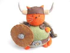 Viking Cat, Cute cat pin cushion, Orange cat, Warrior cat, Cat soft sculpture, Stuffed felt cat, Viking decor, Animal pincushion, MTO by TheFatCatFactory on Etsy https://www.etsy.com/listing/67624228/viking-cat-cute-cat-pin-cushion-orange