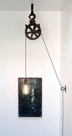 My popular pulley lamp is now a Do-It-Yourself kit! The completed lamp will be a real eye catcher - Ive had a number of unique custom industrial light fixtures in my home but my version of this lamp was always the first one guests asked about! The kit includes: (1) handmade antiqued steel ceiling hook, (1) cast iron tie-off loop, (1) solid brass light socket with an oil-rubbed bronze finish, (1) antiqued steel bulb cage, twelve feet of grey twisted cotton covered cord, (1) quality…