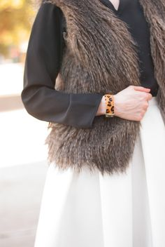 Faux fur vest paired with a little bit of leopard // Click image or shop at https://go2b.uy/%40cheersjenna/32