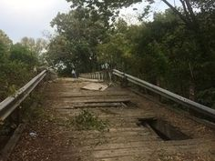 The old, wooden bridge over the Blue Riverlinking W 151st in Johnson County to Kenneth Road in Jackson County, is beingdismantled and will be replaced with a new bridge. The narrow bridge has been closed for several years after a truck damaged