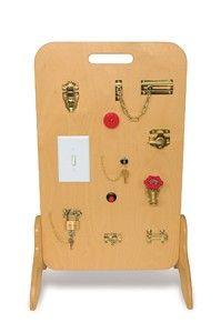 Fine motor board...  Try clothes.  Zipper, buttons, snaps, ties, belt, shoe string, velcro, bow, helmet buckle