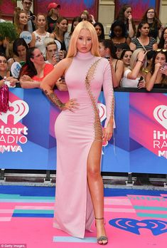 Pretty in pink: Earlier in the night she looked absolutely breathtaking as she hit the red...