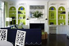 Painting inside shelves and cabinets is a great way to add a splash of colour to your space. This bold lime green is the perfect compliment to a navy sofa and plenty of white trim.