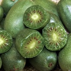 The Kiwiberry (Actinidia arguta 'Issai' is a fast-growing deciduous climbing vine that produces hairless grape sized fruit with the same delicious taste Grapevine Growing, Kiwi Berries, Dwarf Fruit Trees, Garden Express, Lilac Tree, Backyard Trees, Climbing Vines, Growing Grapes, Spring Bulbs
