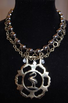 Menono Designs - Upcycle Horse bridle medallion statement necklace - find us on facebook too.