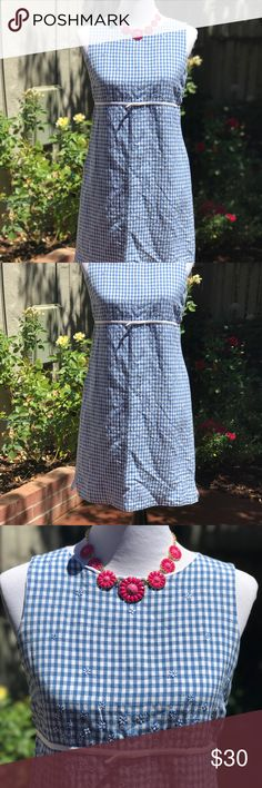 """Talbots gingham w/eyelet flower design Talbots blue/white gingham dress with little eyelet flowers sprinkle throughout. White trim w/bow at empire waist. Hidden back zipper, lined. Shell 55% Linen, 45% Rayon. Liner 100% Polyester. Material has no stretch. Bust 17"""", waist 16"""", hip 18"""", length 35"""". Measurements approx. Mannequin size 6-8, 34x26x35. Talbots Dresses"""