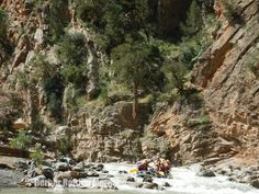 Rafting through the last rapid of the Ahansal canyon.