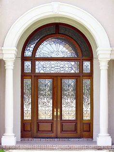 """Estate Exterior Wood Front Entry Door Style DbyD-1001  This awe inspiring GRAND ENTRY is found in Enterprise, AL.  It features a pair of 36"""" X 96"""" Custom Mahogany Exterior Front Entry Doors and 16"""" x 96"""" Sidelites and 3 piece Rectangular Transom with an intricate Leaded Beveled Glass design.  The majestic nature of this unit is added to by the Double Radius Transom with a complimenting Leaded Beveled Glass design."""