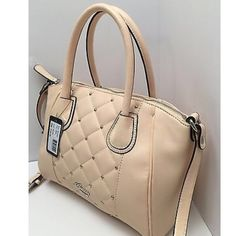 Guess New with tags!!  Always Guaranteed New with tags!!  Always Guaranteed AUTHENTIC.  Description: Guess *San Jose* Collection Style : BB473906 Faux Leather  Color : Creme  Exterior, silver tone hardware  Interior, 4 slip pockets  MSRP $108 Guess Bags Shoulder Bags