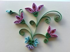 Quilled flowers with multiple colors in one roll