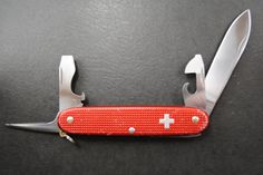 Vintage Victorinox Pioneer RED Alox with Old Cross and BRASS LINER! by HobieonEtsy on Etsy