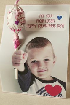 Valentine card with child's photo offering the recipient a lollipop for Valentine's Day