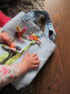 Fine motor busy bag - free tutorial. Many fastenings for a toddler to play. a bright and cheerful bag perfect for fabric scraps