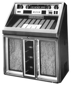 1987, Rowe-AMI's Model R-91 Sapphire, Compact Disc version: played both CDs and 45 rpm records. [Jukebox Collector]