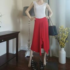 Michael Kors red skirt Like new worn only few times very sexy red skirt the model on my pictures is tall about 5.9 so if you are shorter it will be longer on you, selling skirt only and my other postung im selling the white top also Michael Kors Skirts