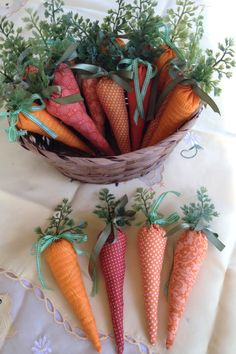 These carrots are perfect as decoration around the house, displayed in baskets or bowls, as well as a filler for children's Easter baskets and even as nameplates for a seating arrangement.Neither children nor grandchildren will reject these carrots. They have been hand crafted from a variety of orange cotton fabrics and stuffed with soft polyester fiberfill. #ad #carrot #easterdecor #fabricdecor #fabriccarro #homedecor #springdecor #easterbasketfiller #fabricvegetable