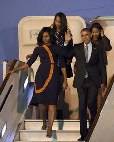 Michelle Obama in Narciso Rodriguez at Ministro Pistarini International Airport in Ezeiza, Argentina on Wednesday. Barrack And Michelle, Michelle And Barack Obama, Narciso Rodriguez, Joe Biden, Durham, Barack Obama Family, Obamas Family, Malia And Sasha, Michelle Obama Fashion