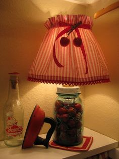 I had the lamp and made the little shade cover. A lamp makes it a cozy space. The little water sprinkler was my Mom's.
