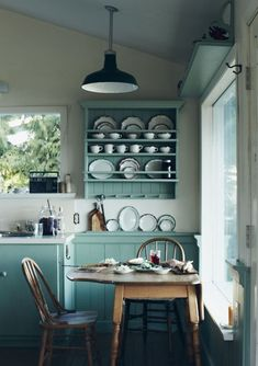 Charming Treasures. Lovely country kitchen. Soft hues.
