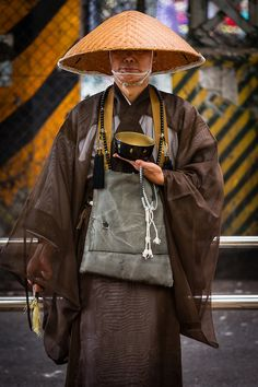japanese buddhist monk waiting patiently for donations outside the ueno train station, tokyo