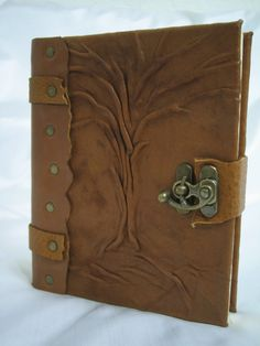 Handmade Leather Journal Love leather and metal together. And the tree design really makes it.