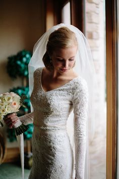 Featured Bride Zoe in a modest wedding dress by Liancarlo from Alta Moda. Photo…