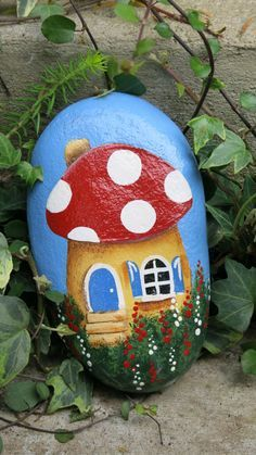 This rock was painted sky blue and then a red roof cottage was added. The back has been left unpainted. Would be perfect for a fairy garden. It does not stand on its own, either lay it flat or prop it against another object. Approximately 6 x 3.5 wide and 1 3/8 thick. A satin exterior polyurethane varnish has been applied. (a shady spot in the garden is best to maintain the bright colors)