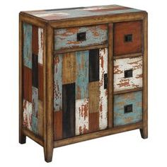 Four-drawer cabinet with a storage cupboard and a distressed multicolor patchwork motif.  Product: CabinetConstruction Material: Reclaimed woodColor: Teal, brown and greyFeatures:  Four drawersOne door Dimensions: 34 H x 38.5 W x 16 D