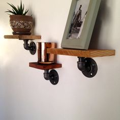 Wall Shelf Set // Set of Three Wall Shelves // Reclaimed Wood & Pipe on Etsy, $59.50