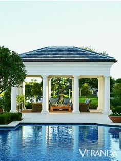 This pavilion by Robert Hart is the perfect gathering place for cocktails or dinner with Fondovalle and Cercan Tile tiles, a Restoration Hardware coffee table, and Wicker chairs by the pool. See more beautiful pools. Outdoor Rooms, Outdoor Living, Living Pool, Gazebos, Pool Cabana, Luxury Pools, Beautiful Pools, Dream Pools, Pool Landscaping