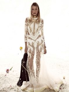 Roos models sheer Givenchy gown