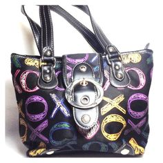 XOXO HANDBAG  Super Cute  SALE XOXO Black Handbag with Colorful Hearts and XO's in purple, pink, yellow, blue outlined & green colored in. 8 in length about 10-11 in wide. There is a very very tiny mark in the leather handle that I took in the last picture. it's not noticeable unless examined very close. Zips and has a button to close. Pocket inside. Feel free to contact me if u have ?s I do negotiate and bundle. I'm also willing to trade TY XOXO Bags Totes