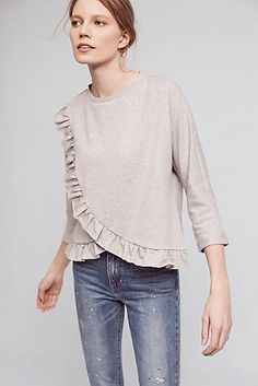 This is not the Ashcreek Poncho. It is the Ruffled Terry Top by Eri + Ali new at Anthro. I am going to order it ASAP!