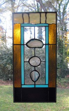 """Bisbee Turquoise - Agates w/Turquoise and Amber Glass: Stained Glass Panel with 3 Agates (approx 9"""" wide x 18.5"""" tall) by ArtGlassInspired on Etsy"""
