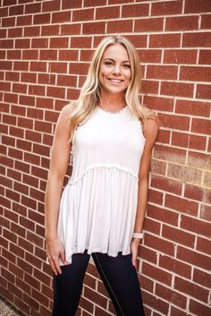 Say hello to springtime with the white pol top. Sleeveless and lovely, this piece plays on texture and detail. With a fitted top that lets out to a more flowy bottom half, this top will keep you comfortable and chic all day long.