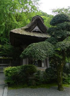 Japanese garden elements and a thatched roof