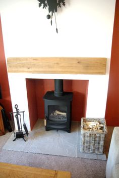 Our log burner and oak mantlepiece.  Lovely. This our new log burner in our newly renovated lounge. One room down, only 9 to go!