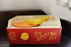 ...fisher price record player-had one of these when i was super lil-my mom has a picture of me in the floor playing with it