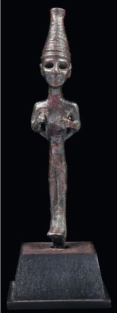 Cananean votive bronze statuette figuring a standing divinity, late 2nd millennium B.C. 12.6 cm high. Private collection