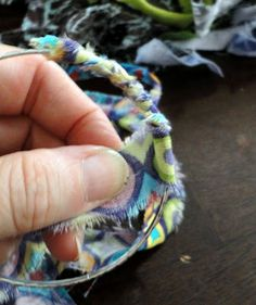 And then... I wrapped the fabric around the bracelet. Was a pretty simple process, and when I came to the end (where the fabric overlapped), I secured it with some glue and a couple of stitches.  To add a bit more support to it, I wrapped it with some co- ordinating perle cotton too.