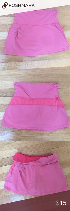 """Athletic skirt with built in spandex shorts Athletic tennis skirt, built in spandex shorts underneath, very stretchy, folds over at the top or you can wear as is, a coral pink color, the body is nylon and spandex, 15"""" long Kyodan Skirts"""