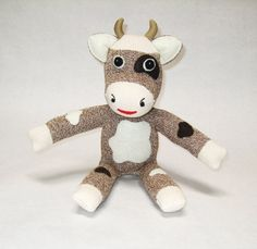 Hey, I found this really awesome Etsy listing at http://www.etsy.com/listing/122701068/stuffed-cow-toy-rockford-red-heel-sock