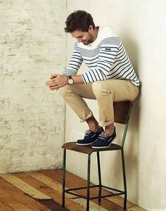 Shop this look on Lookastic:  http://lookastic.com/men/looks/white-and-navy-horizontal-striped-crew-neck-sweater-khaki-chinos-navy-suede-boat-shoes/9027  — White and Navy Horizontal Striped Crew-neck Sweater  — Khaki Chinos  — Navy Suede Boat Shoes