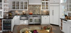 Stainless appliances and white cabinets can create a traditional kitchen look