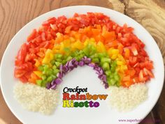FOOD - Crockpot Rainbow Risotto {With Peppers}. My kids went back for seconds for this cheesy Crockpot Rainbow Risotto! You must try it!    Healthy Ideas for Kids #pickyeaters #healthymeals #slowcooker #vegetablesforkids http://www.superhealthykids.com/blog-posts/crockpot-rainbow-risotto-with-peppers.php