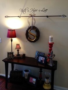 Curtain rod over entry way table, can change up wreaths for each Holiday!