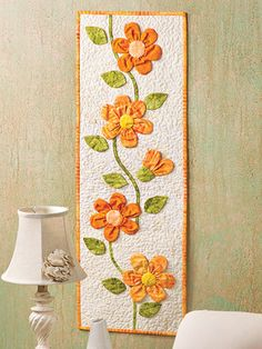 Peachy Keen Wall Hanging.....(I love these fabric flowers! What a great way to use them!)b