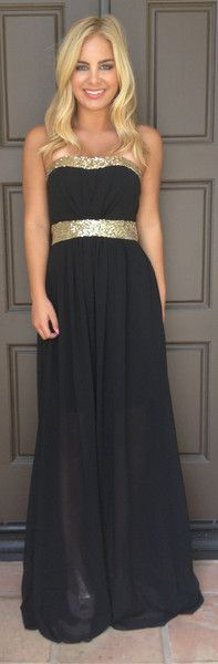 This strapless dress features sequin detailing at the front, a padded bust, elasticated ruching at the back for a great fit, and this dress is partially lined.